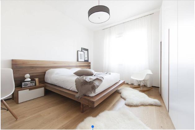 Ліжко в інтер'єрі спальні мінімалізм фото
